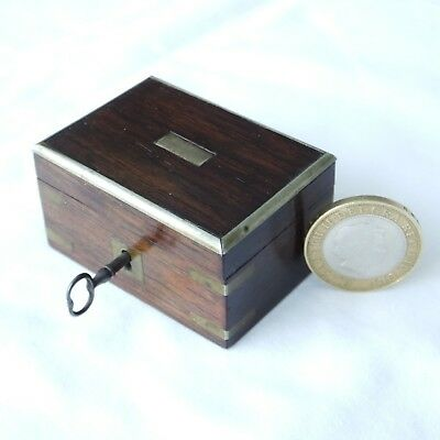 A antique, miniture rosewood travel chest with lock and key