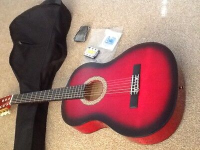 Classical Guitar in stunning red- perfect for beginner. Collect from  Kettering