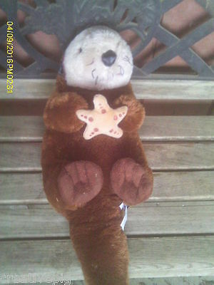 LARGE Plush Sea Otter Holding Plush Starfish in Front Paws