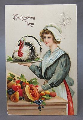 1910 THANKSGIVING young maiden carrying TURKEY on platter embossed postcard *