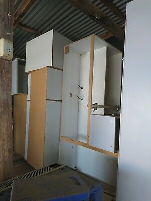 Used kitchen cabinets, doors, handles and hinges and bench tops.
