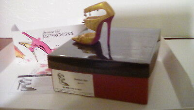 Golden girl.  Signed. Just the right shoe miniature collectible