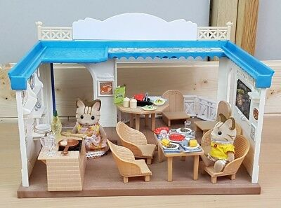 Sylvanian Families Seaside Restaurant with 2 figures and accessories.