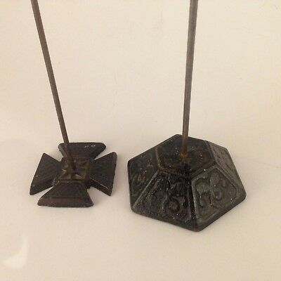 Two antique metal Victorian receipt spikes, Hexagon and Maltese cross