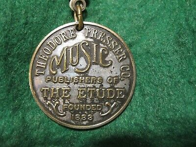 Old Presser Music Co. Etude publisher charge coin or key return #600 brass tag
