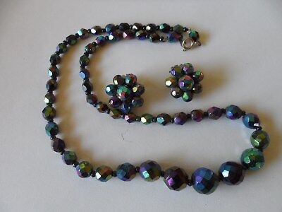 Unique.Beautiful necklace&earings purple,blue & green. Focal point.