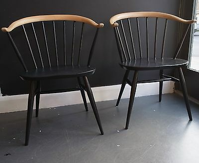 A pair of vintage 1960s Ercol 'cowhorn' windsor chairs