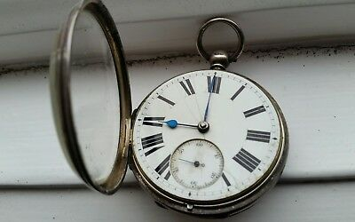 Antique silver pocket watch with key