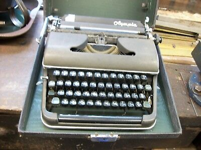 Olympia portable typewriter in a wooden casecase.