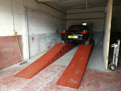 Drive on servicing garage ramps
