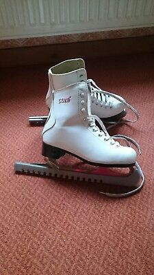 ICE SKATES. Girls/ Ladies size 37 or UK 5 . ISK8 white skating boots + guards.