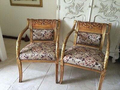 Pair of neo classical style gold guilded armchairs