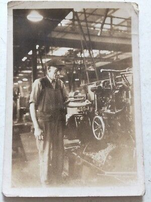 Small photo man with lathe unknown factory