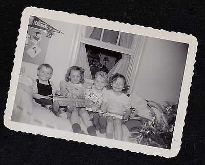 Old Vintage Antique Photograph Four Children Sitting on Bed With Christmas Gifts