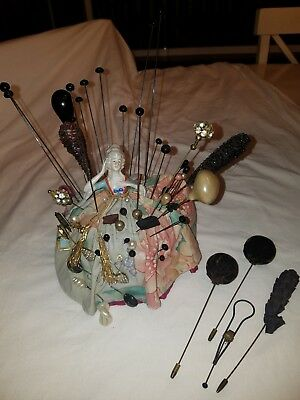 Antique hat pin collection with antique lady pin cushion