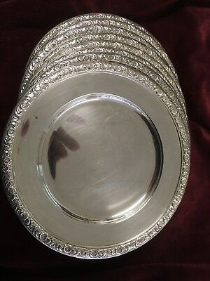 Eight Prelude by International sterling bread and butter plates.