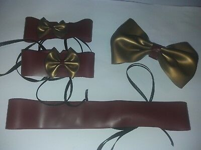 plum red and gold latex rubber dress up set. cuffs, bow clip and collar