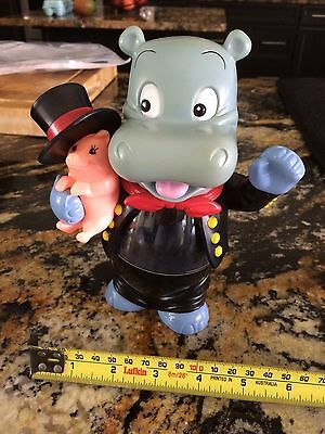 Extra Large Kinder Hippo Hippopotamus holding a pig with a top hat
