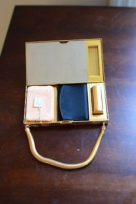 Vintage Evans gold metal compact purse, NEVER USED