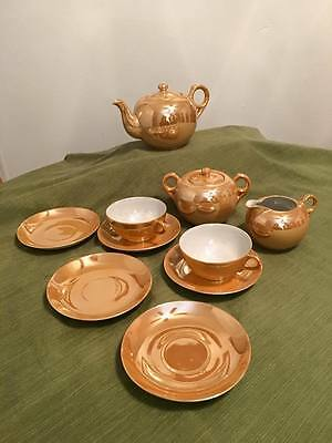 Antique Japanese peach porcelain tea set