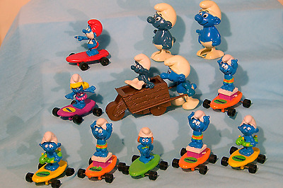 11 Assorted SMURFs Figures by Peyo  Wind Up Walkers  Skateboards
