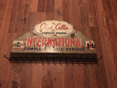 """Vintage International Harvest Check Cables Tin Sign With Hooks 12"""" x 22"""""""