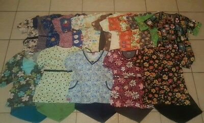 scrubs lot xs and small 20 tops, 9 sets, 7 pants, and 4 white coats.