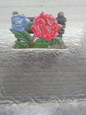 cast iron napkin holder red blue flower green with black fence