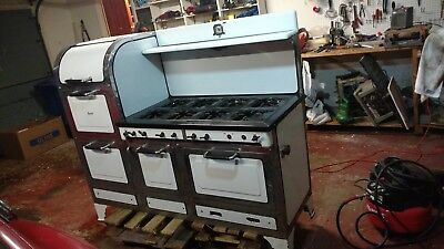 Magic Chef 1919 w/ 8 burners, 2 ovens, 2 broilers, and warming room. Very Rare.