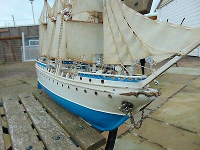 vintage model wooden sailing ship with 4 canons needs some TLC repairs