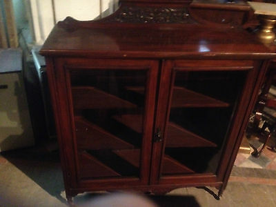exceptional victorian carved mahogany book case with glass doors
