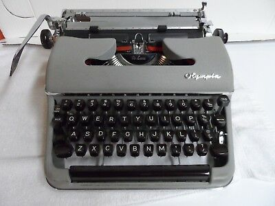 Vintage OLYMPIA Portable Typewriter  Best of condition  LOOK