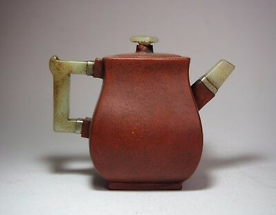 A Yixing Clay Teapot with Jade Handle and Spout