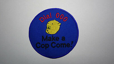 shoulder patche - dial 000n and make a pig come