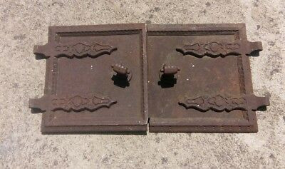 Old cast iron pizza oven doors with knuckle handles