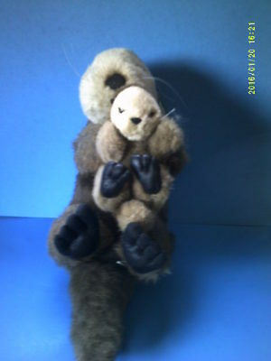 Plush Realistic Adult Floating Otter Holding Baby on Chest