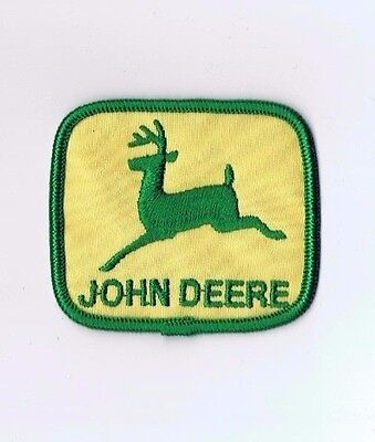 one John deere green and yellow in middle