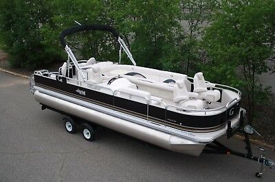 New 24 ft pontoon boat with reclining chairs with 60 Mercury and trailer