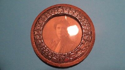Small round antique silver picture frame.