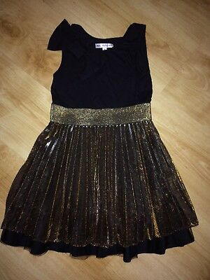 girls marks and spencer autograph black and gold party dress. Age 8 years.