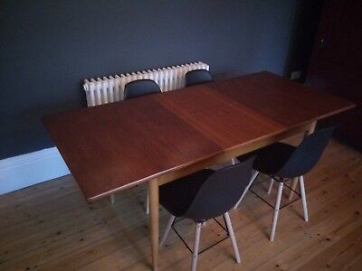mid century danish style extending dining table and 4 Eames style chairs