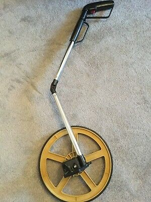 FOLDABLE DISTANCE MEASURING WHEEL WITH STAND & BAG . Kept In Storage Unused