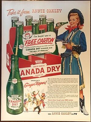 1954 Canada Dry Ginger Ale Print Ad- Cowgirl ANNIE OAKLEY buys you a Free Carton