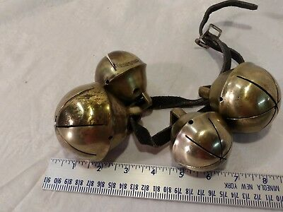 Antique brass sleigh bells - set of 4 on leather strap