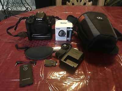 Canon EOS Rebel SL1 / EOS 100D 18.0MP Digital SLR Camera - Black Body Only