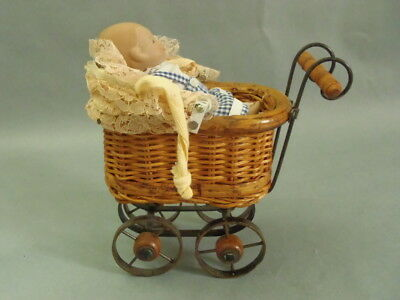 Vintage Wicker and Metal Small Baby Doll Carriage Stroller & All bisque doll