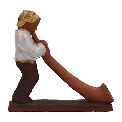 A studio pottery figure of an alpine horn player Swiss ? Signed Meister Rosa