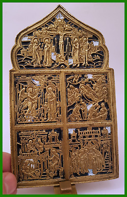 Russian orthodox bronze icon with selected Feasts. Enameled.