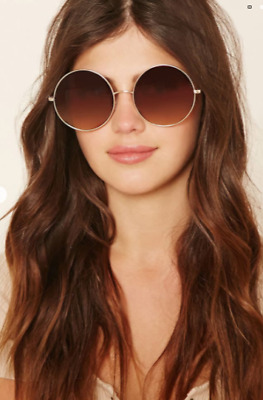 A Pair of Oversized Round Sunglasses Slightly Gradated Lenses High Polish