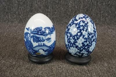Set Of Two Porcelain Hand Painted White & Blue Egg Figurines On Wood Stands